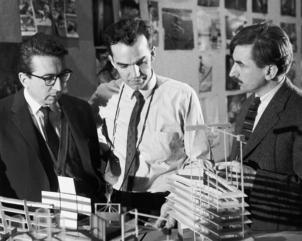 Colin Low (center) and Roman Kroitor (right) discussing Labyrinth Pavilion for Expo 67 Montreal
